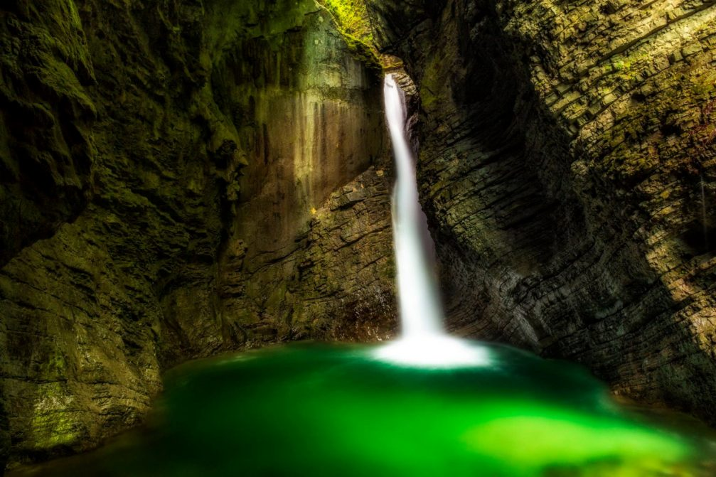 Kozjak Falls with an emerald green pool at its base