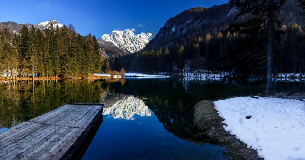 Lake Plansarsko Jezero in the Jezersko valley in winter with snow