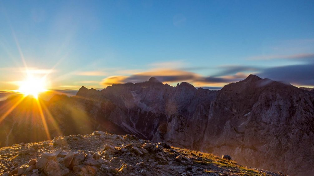 A beautiful sunrise in the Julian Alps as seen from the Mala Mojstrovka summit