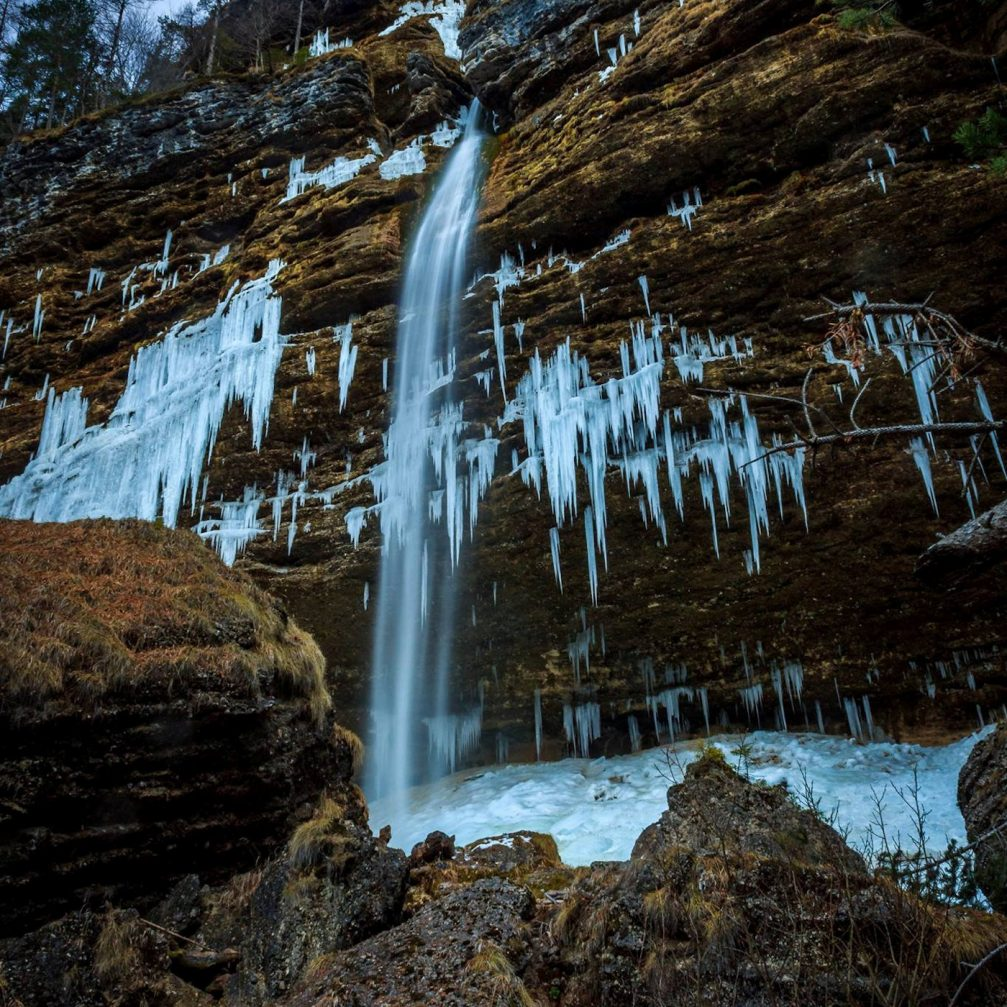 The Pericnik falls in winter when the water freezes into thick curtains of ice
