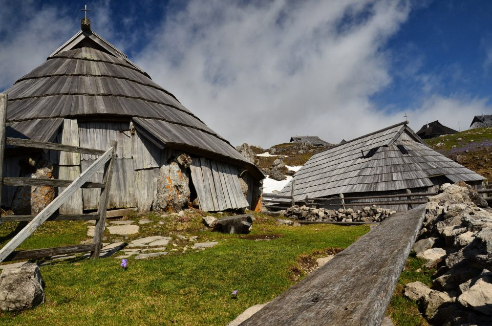 The oval herdsmen's hut covered from roof to ground with shingles on the Velika Planina plateau