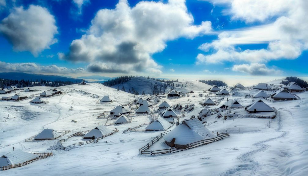 The Velika Planina high-elevation Alpine settlement in winter with lots of snow