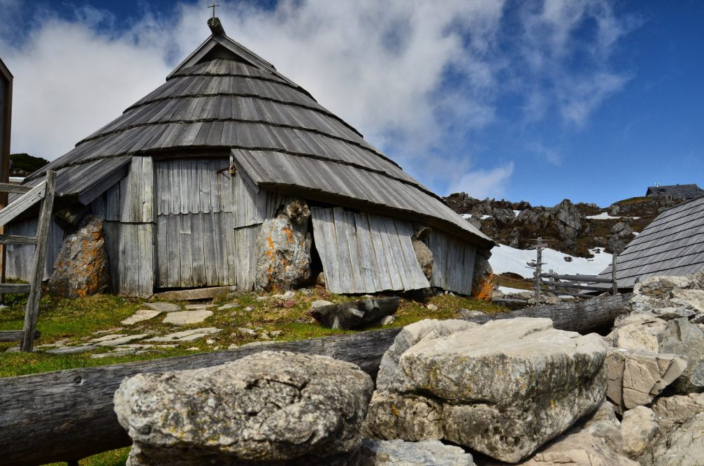 The low lying rounded shepherd's huts with conical roofs on the Velika Planina pasture