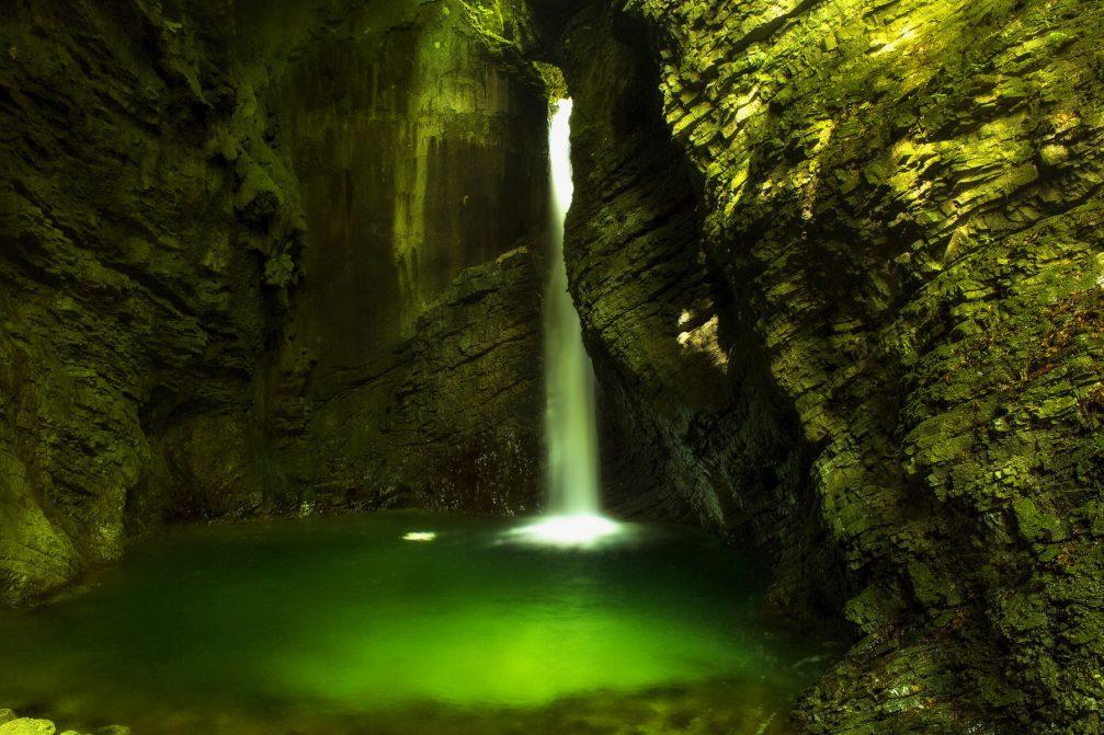Kozjak Waterfall near Kobarid, Slovenia with an emerald pool at its base