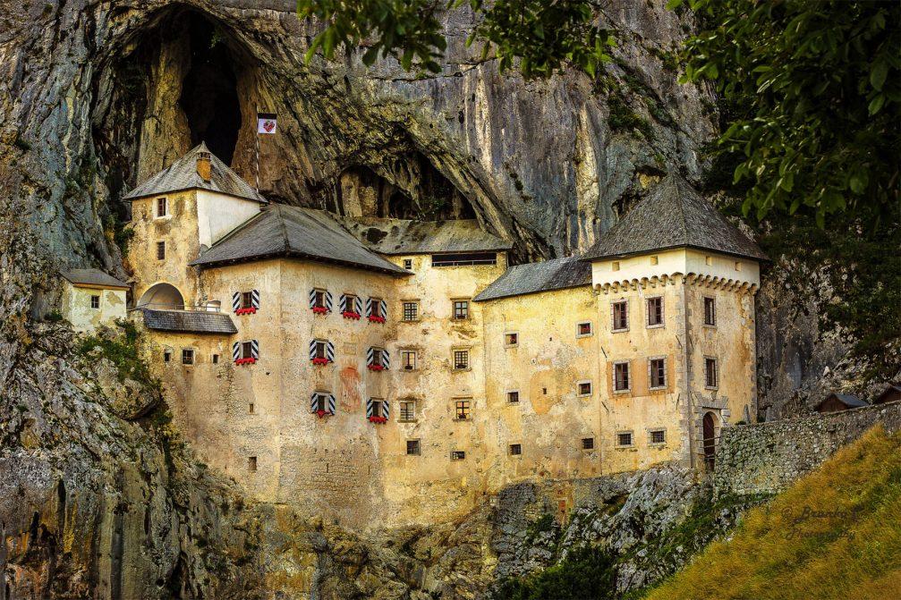 Predjamski Grad Castle perched in the middle of a cliff near Postojna, Slovenia