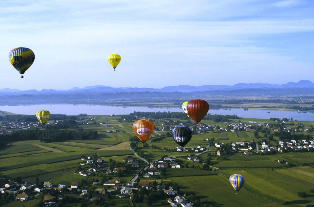 An aerial view of the hot air balloons above the Dravsko Polje in Slovenia