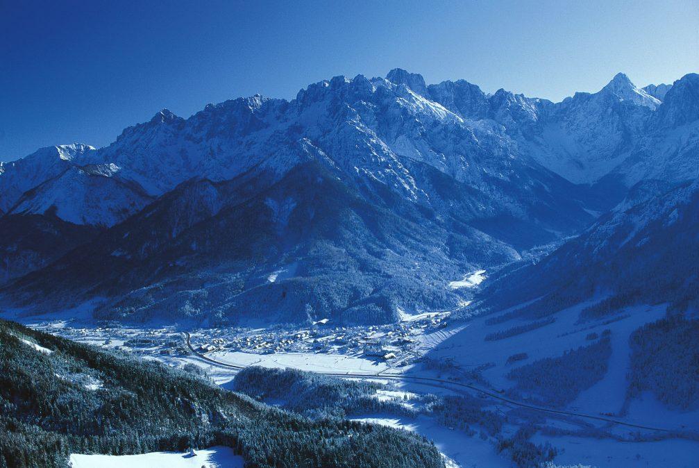An aerial view of the alpine village and ski resort of Kranjska Gora in winter
