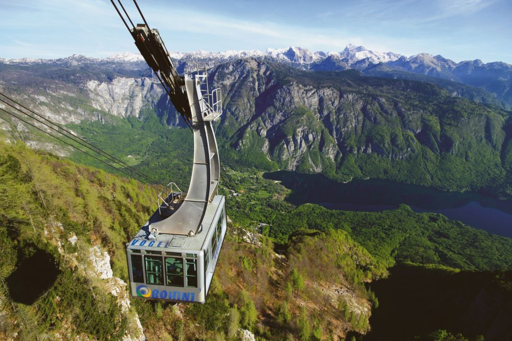 An aerial view of the Vogel cable car above Lake Bohinj in northwestern Slovenia