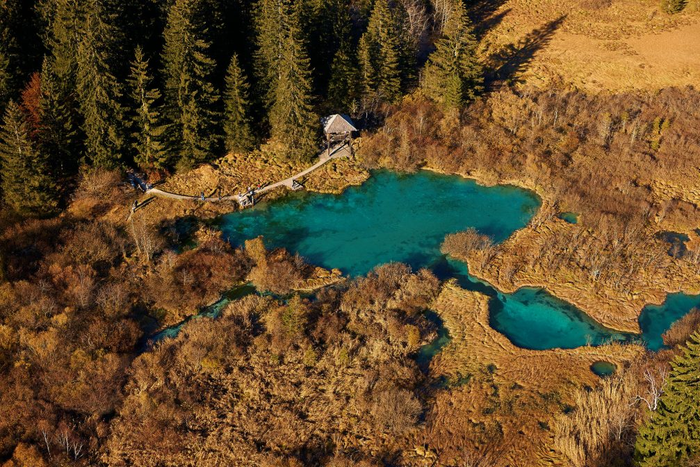 An aerial view of the Zelenci lake and nature reserve in northwestern Slovenia
