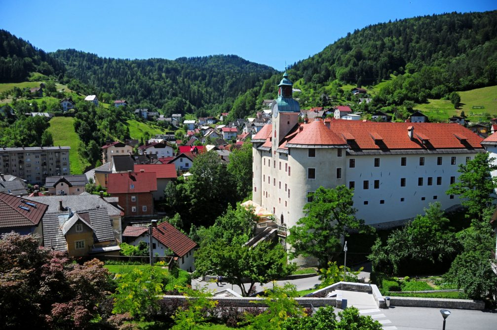 Exterior of the Gewerkenegg Castle with the town of Idrija, Slovenia in the background
