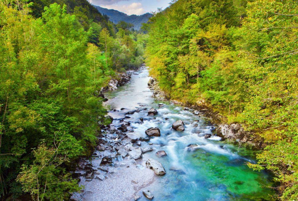 The Idrijca river flowing through the Idrija Hills in western Slovenia