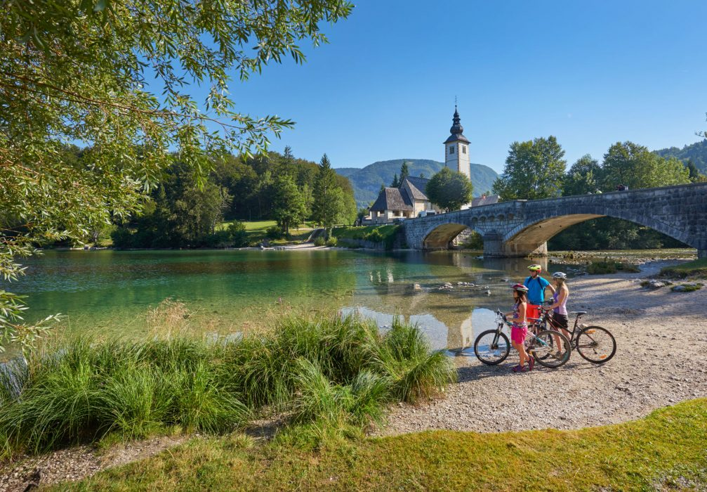 A family stop to take in the view of Lake Bohinj in Slovenia