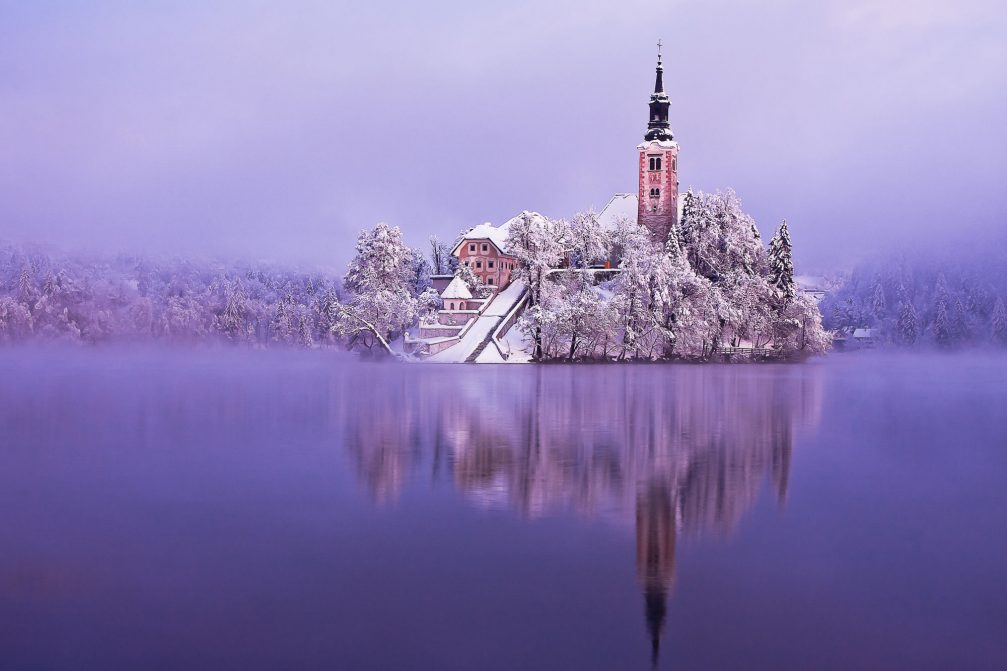 Bled Island with a church in the winter with snow