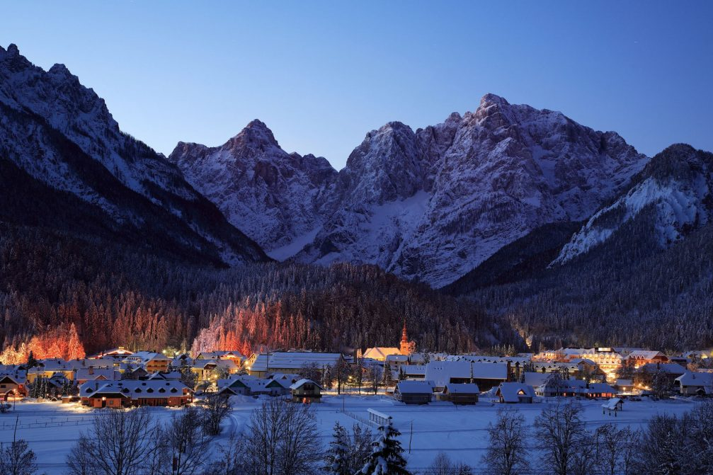 Kranjska Gora covered with a thick layer of snow at night in the winter time