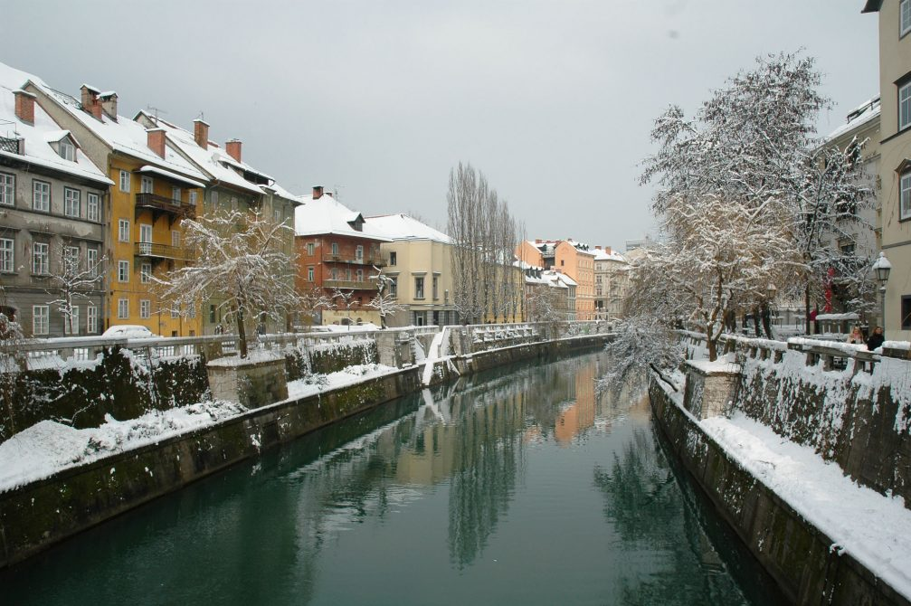 The Ljubljanica River flowing through Slovenia's capital Ljubljana covered in snow in the winter time