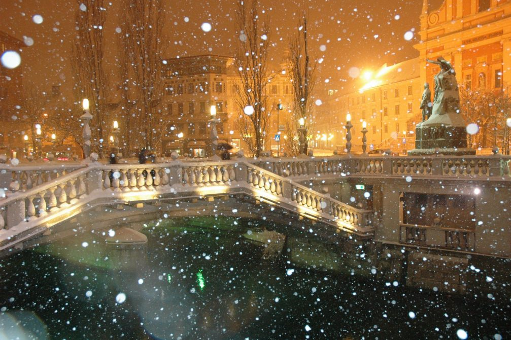 The Triple Bridge in the Old Town centre of Ljubljana during snowfall in the winter