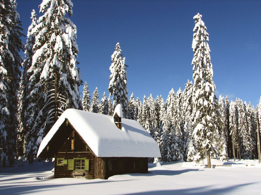 A lonely cottage at the Pokljuka Plateau covered with snow in the winter