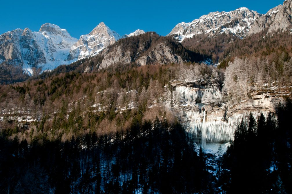 Waterfall Pericnik in Slovenia frozen into a wall of icicles in the winter