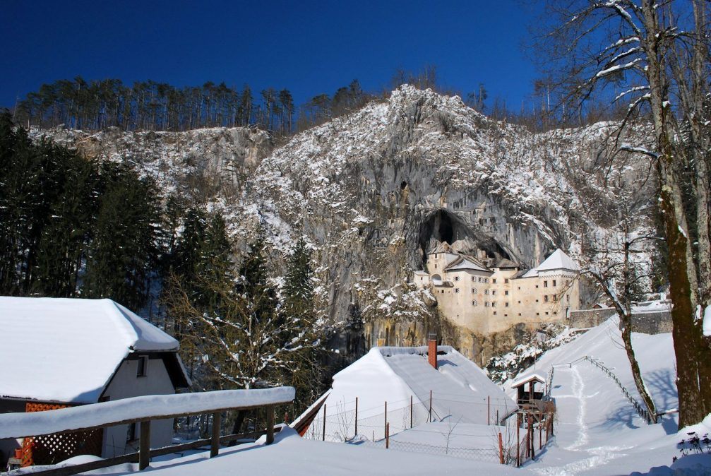 The Predjama Castle covered with a thick layer of fresh snow in the winter
