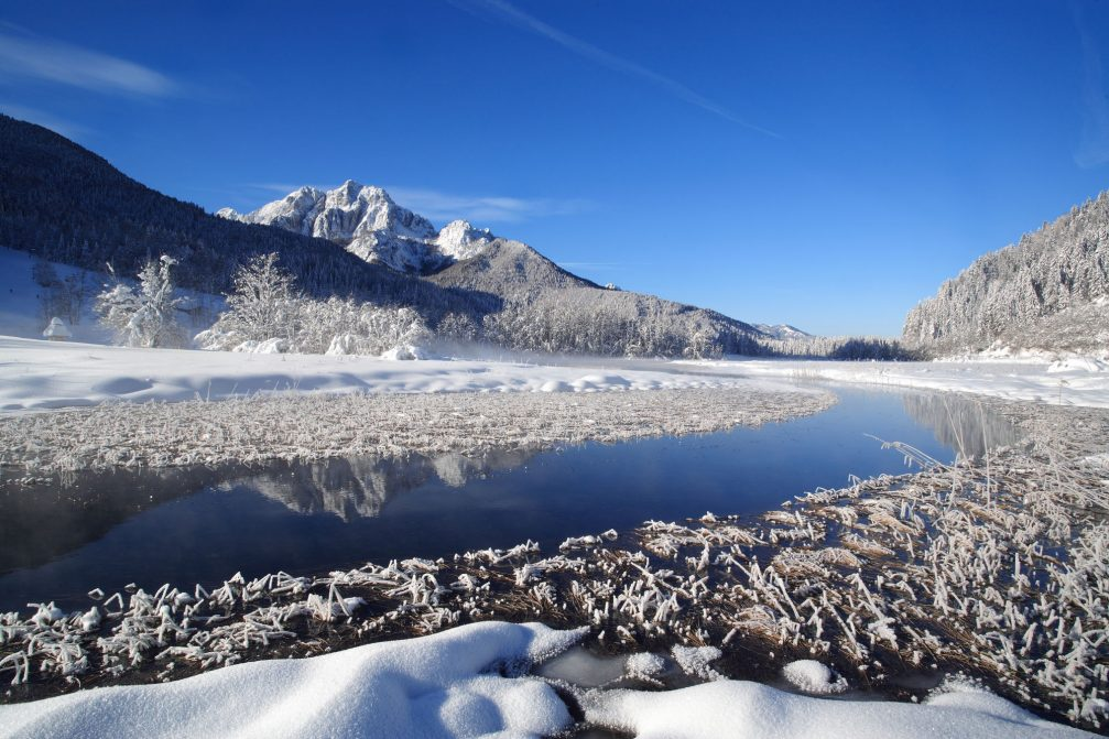 The Sava Dolinka river flowing through the Upper Sava Valley in the winter time