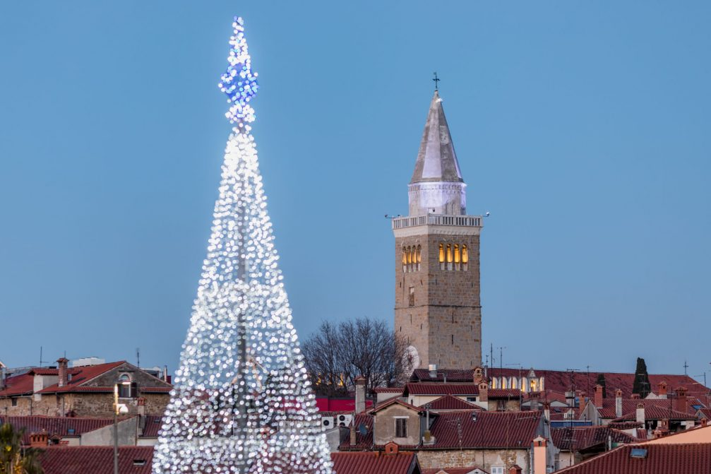 Koper Old Town with the Bell Tower and richly decorated Christmas Tree during the festive season